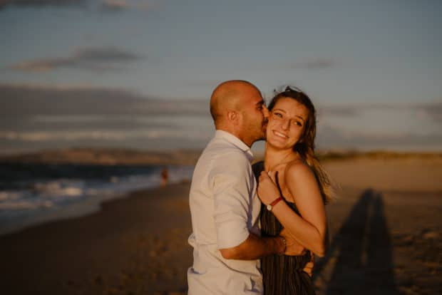 Engaged on the beach in Sassari