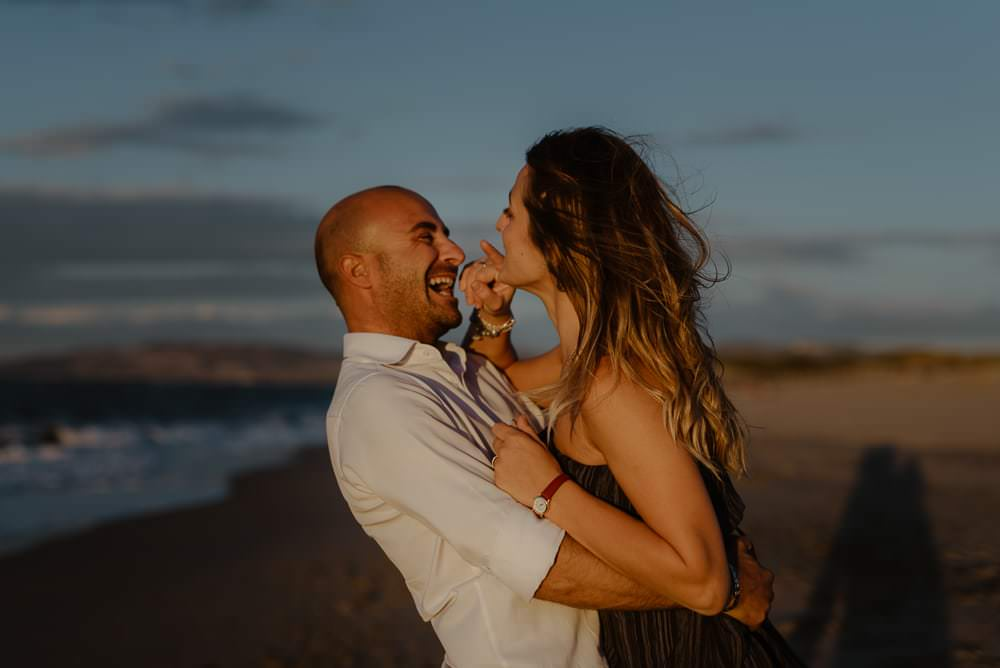 Engaged on the beach in alghero
